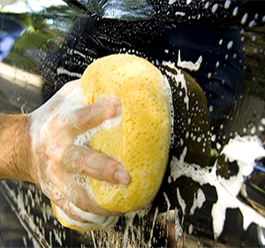 TONY'S ELITE MOBILE DETAILING expert washing black car